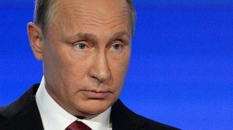 Russian President Vladimir Putin speaks at a meeting