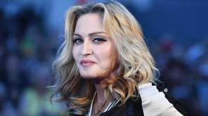 US singer-songwriter Madonna poses arriving on the carpet