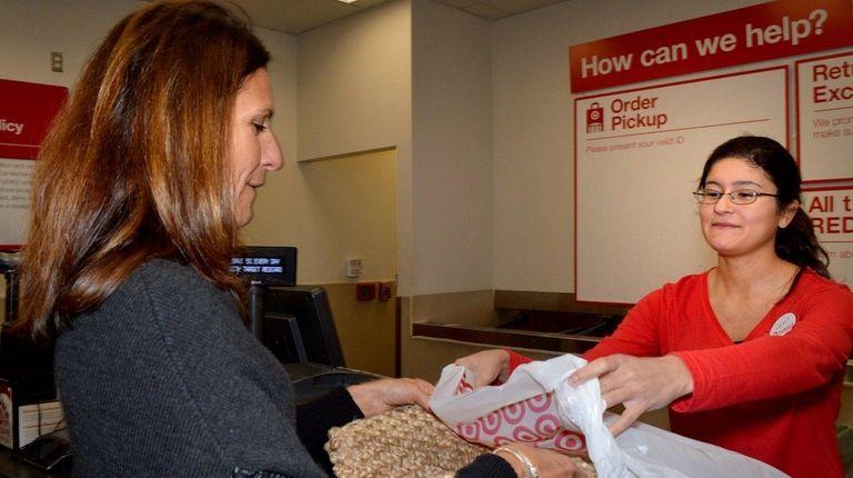 Lisa Rossi, of Merrick, picks up a doormat