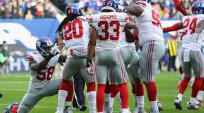 Owa Odighizuwa celebrates the touchdown of Landon Collins