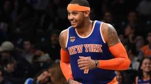 The Knicks' Carmelo Anthony reacts after he sinks
