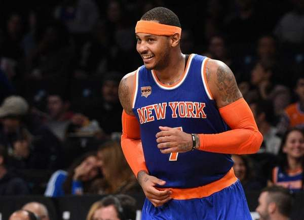 The Knicks' Carmelo Anthony reacts after sinking a