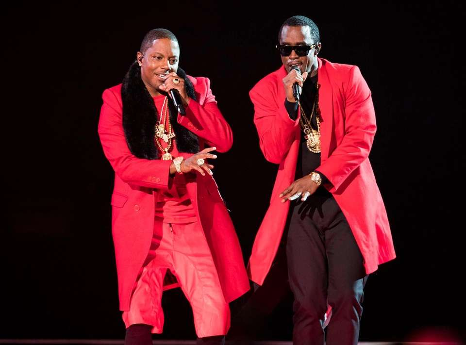 Mase, left, and Puff Daddy perform onstage during