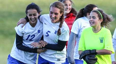 From left, Portledge's Arianna Marciano, Celine Dobler and