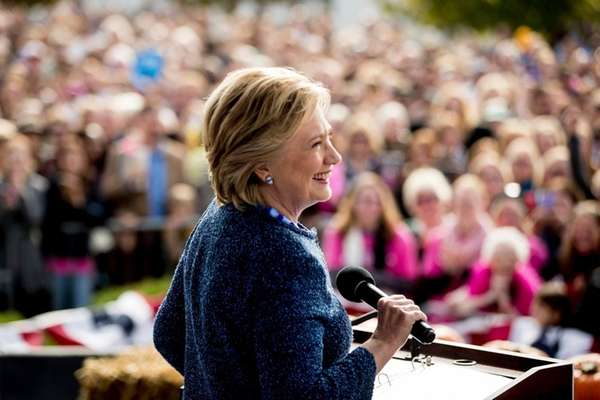 Hillary Clinton pauses while speaking at a campaign