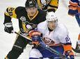 Pittsburgh Penguins' defenseman Ian Cole (28) ties up