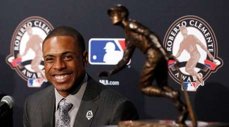 The New York Mets' Curtis Granderson smiles at