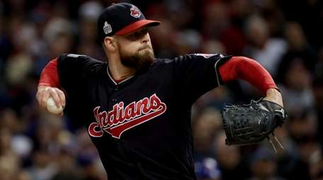 Cleveland Indians starting pitcher Corey Kluber throws against
