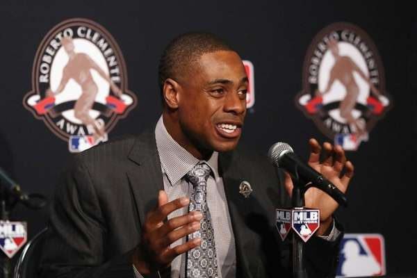 Curtis Granderson speaks to the media after being