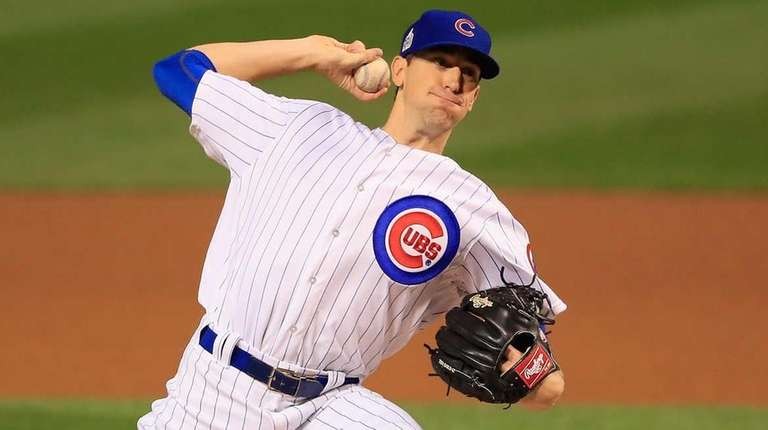 Kyle Hendricks of the Chicago Cubs pitches in