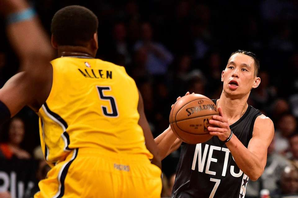 Brooklyn Nets' guard Jeremy Lin (7) is defended