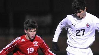 Michael Rodrigues #27 of Mineola, right, and Ryan