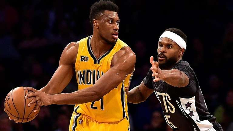 Indiana Pacers' forward Thaddeus Young (21) is defended