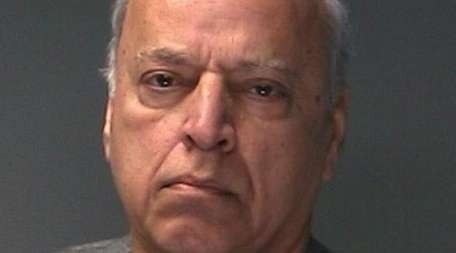 Aziz Khan, 65, of Dix Hills was arrested