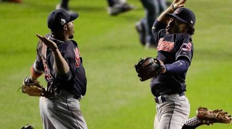 Cleveland Indians shortstop Francisco Lindor, right, and center