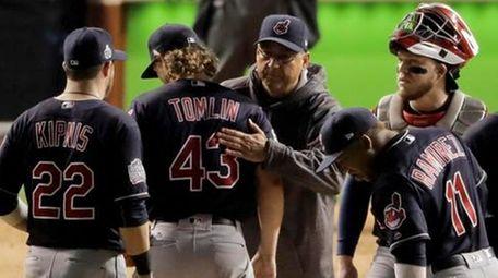Cleveland Indians starting pitcher Josh Tomlin gets a