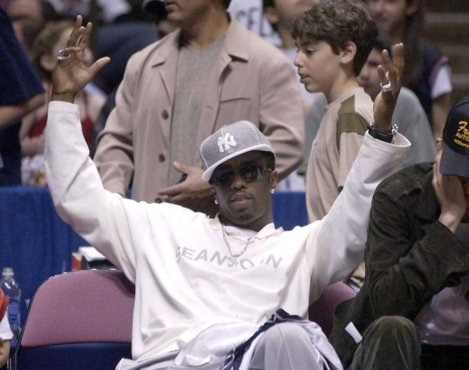 Sean Puffy Combs watches the New Jersey Nets