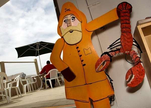 Joe the Lobster Man greets guests at