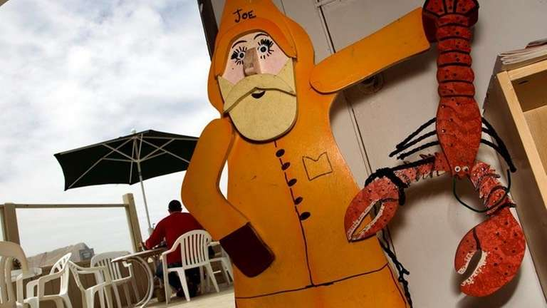 Joe the Lobster Man greets guests at