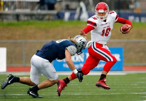 Stony Brook Seawolves quarterback Joe Carbone tries