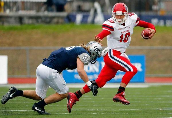 Stony Brook Seawolves quarterback Joe Carbone tries