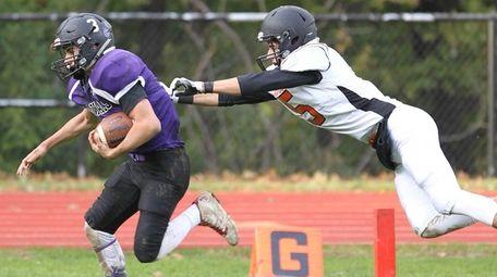 Port Jefferson's Joey Evangelista (3) runs the ball