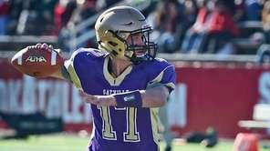 Sayville's Jack Coan drops back for a pass