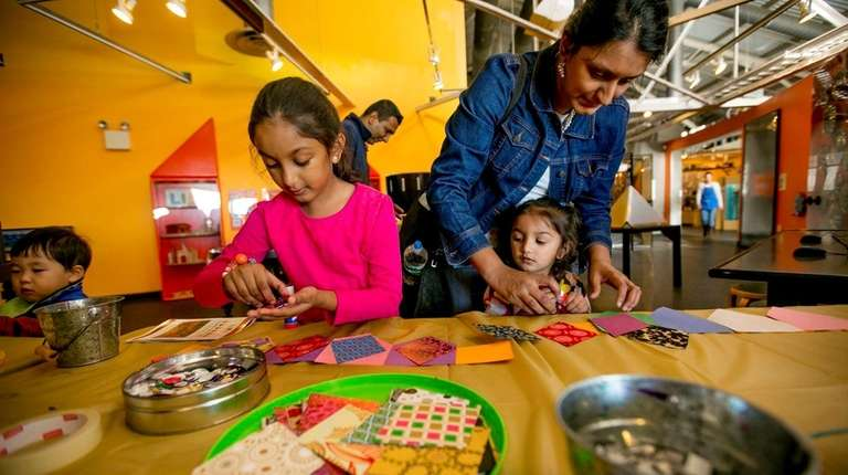 Five-year-old Jiya Panchamia, left, and her sister 2-year-old