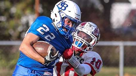 North Babylon's PJ Tchinnis can not get away