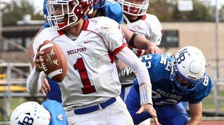 Quarterback James Morrell of Bellport avoids North Babylon's