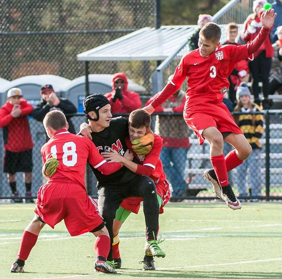 Center Moriches' Dylan DeLong (18, left), GK Alec