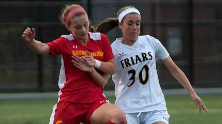 Sacred Heart's Caitlin Kennedy, left, and St. Anthony's