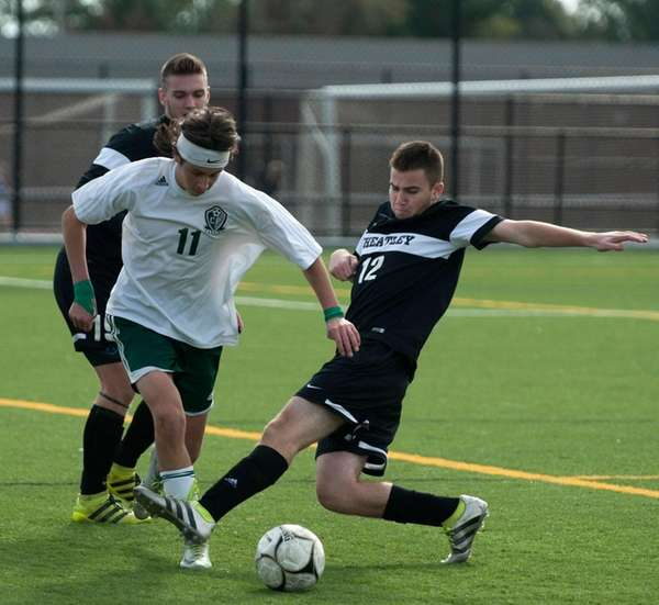 Carle Place's Clay Pines, left, battles against Wheatley's