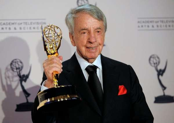 Norman Brokaw with the Governor's Award from the