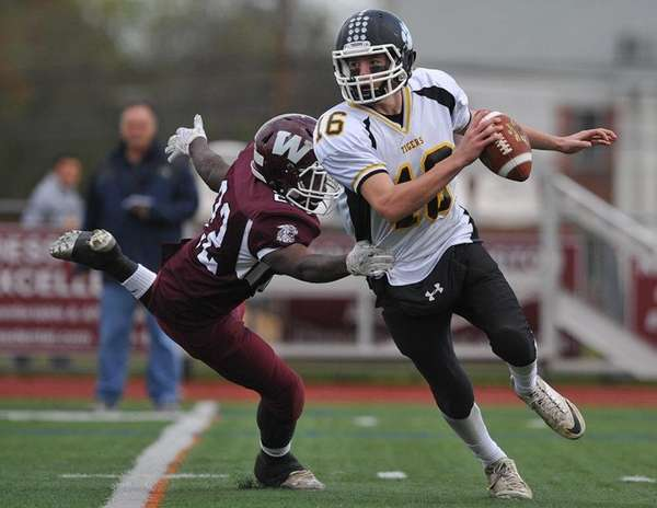 Ryan Walsh #16, Northport quarterback, right, scrambles out