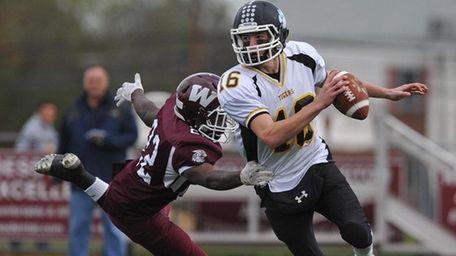 Ryan Walsh #16, Northport quarterback, right, scrambles out