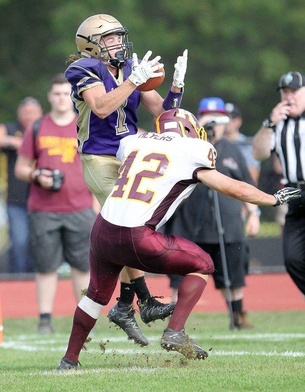 Sayville's Jake Kolar (1) catches a touchdown pass