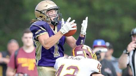 Sayville's Jake Kolar (1) catches a touchdown pass