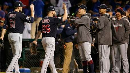 Cleveland Indians celebrate after a win in Game