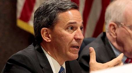 Senator Jack Martins asks questions during the water