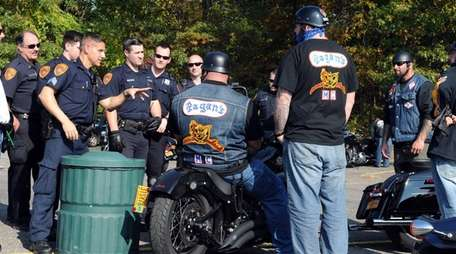Suffolk County police officers instruct Pagans bikers to