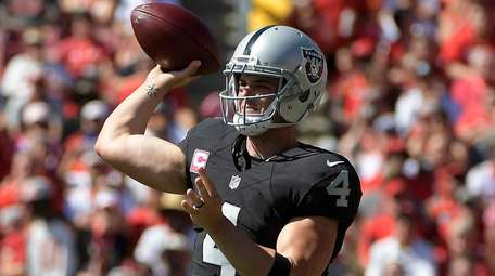 Oakland Raiders quarterback Derek Carr (4) throws a