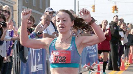 Women's full marathon winner Pam O'Sullivan of New