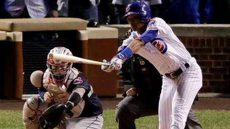 Chicago Cubs' Addison Russell hits a RBI single