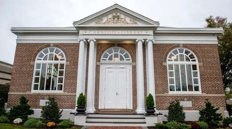 The 108-year-old Carnegie Library in Patchogue, shown Oct.