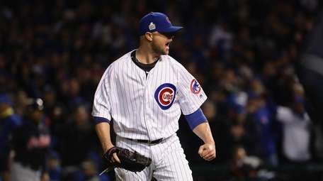 Jon Lester of the Chicago Cubs reacts after