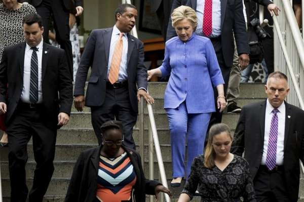 Democratic presidential candidate Hillary Clinton, right, speaks with