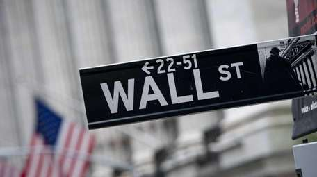 The Wall Street street sign is seen outside
