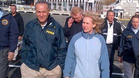U.S. Sens. Chuck Schumer and Kirsten Gillibrand, center,
