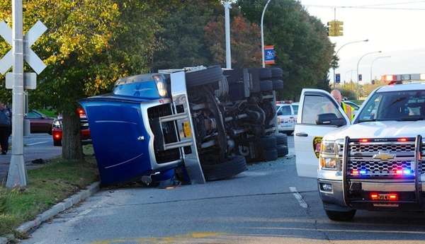 A garbage truck overturned while making a turn
